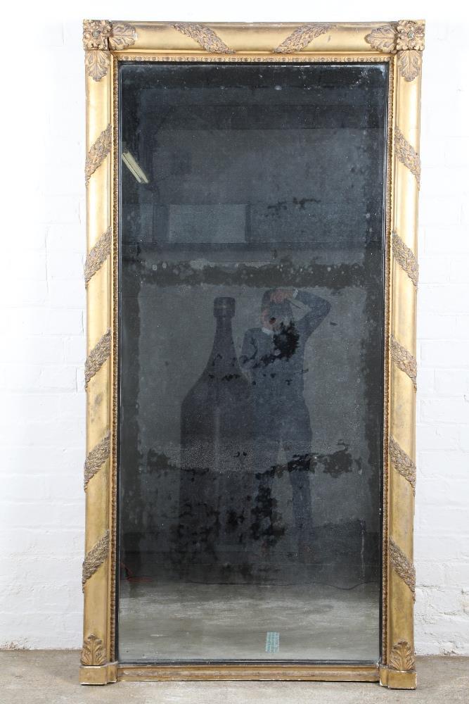 A large Regency gilt framed overmantelmirror, with acanthus leaf decoration, 212cm high, 108cm