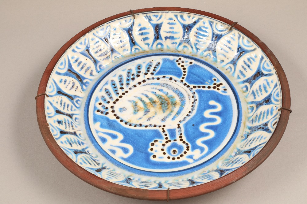 Scottish studio pottery, Robert Sinclair Thomson (1915-1983) wall charger, blue and white enamels,