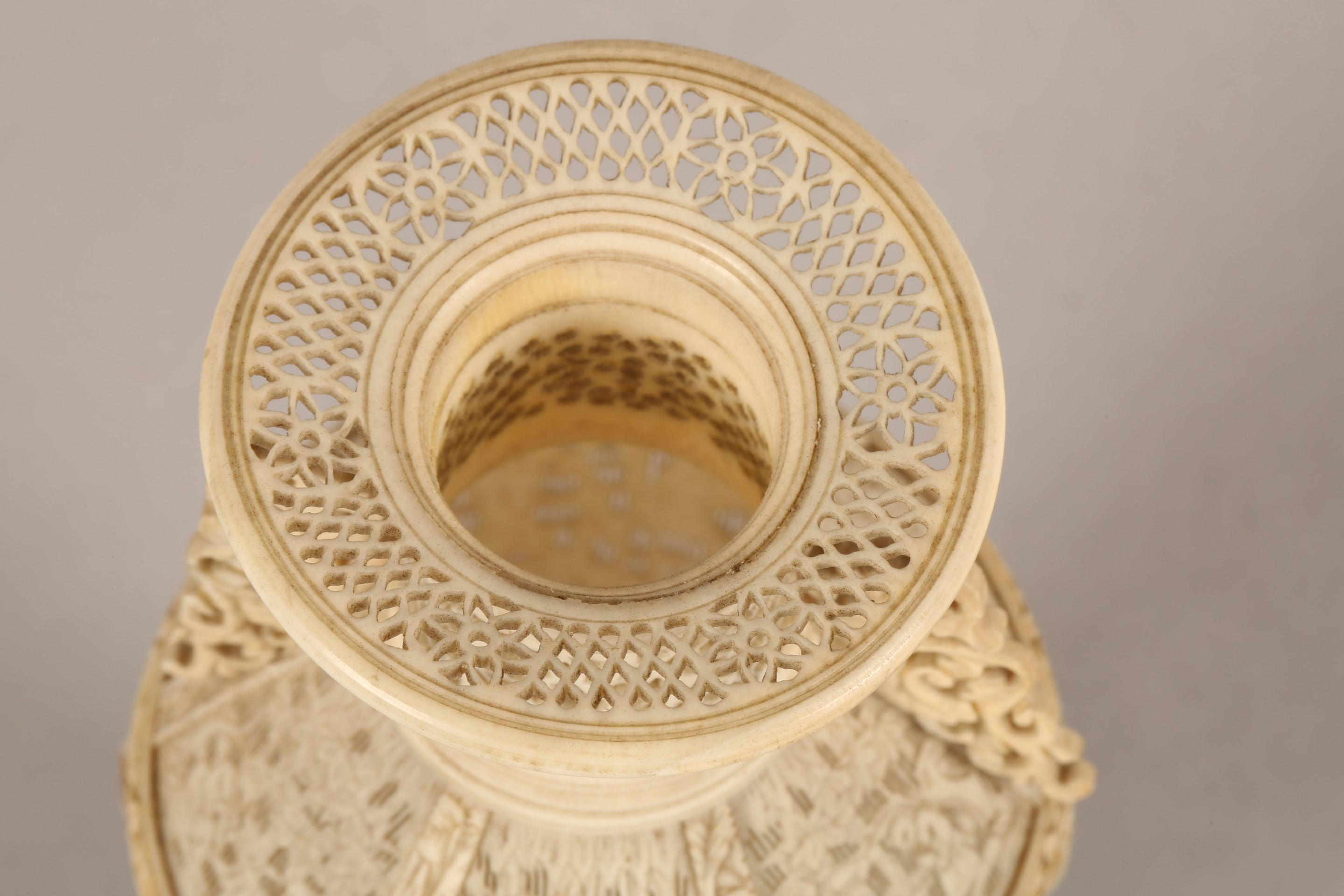 19th century Chinese Canton reticulated ivory twin handled vase (minor damages) 17.5cm high. - Image 2 of 7