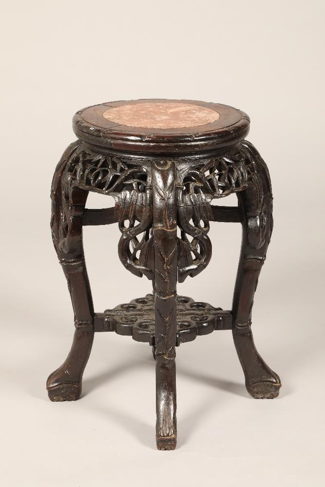 Chinese hardwood jardinière stand, rouge marble insert, carved bamboo apron supported on four carved
