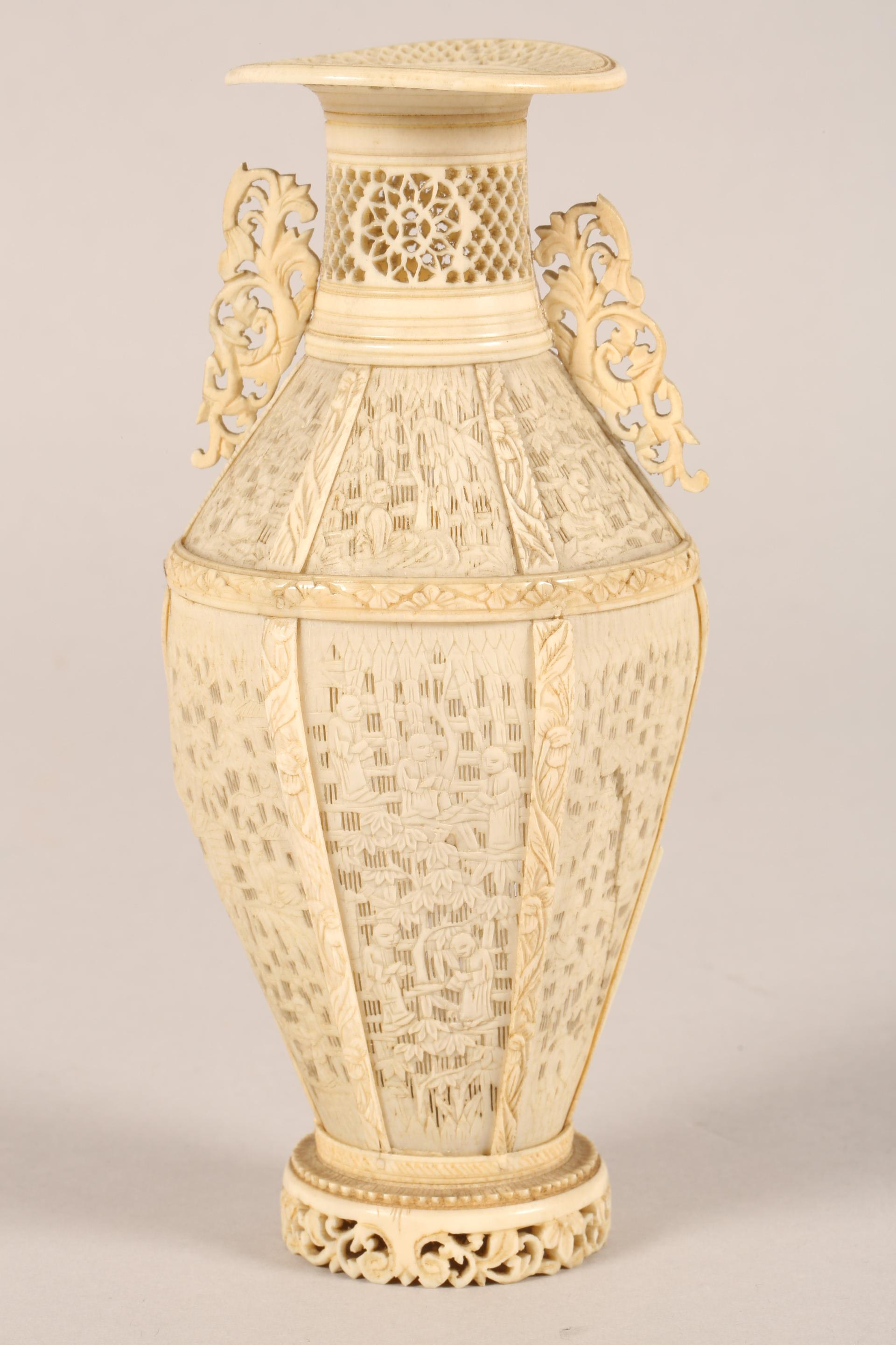19th century Chinese Canton reticulated ivory twin handled vase (minor damages) 17.5cm high. - Image 3 of 7