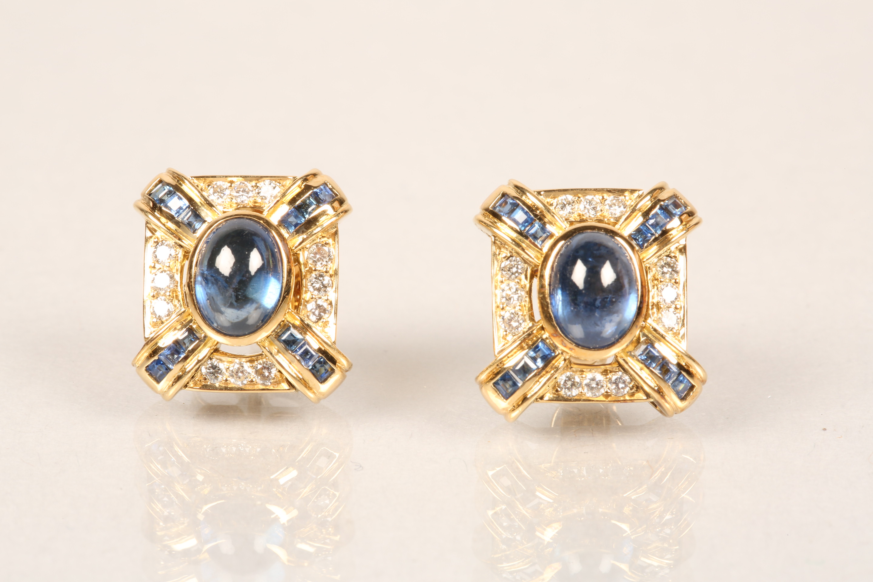 Boxed pair of 18 carat gold earrings, each set with a central blue sapphire cabochon surrounded by - Image 3 of 6
