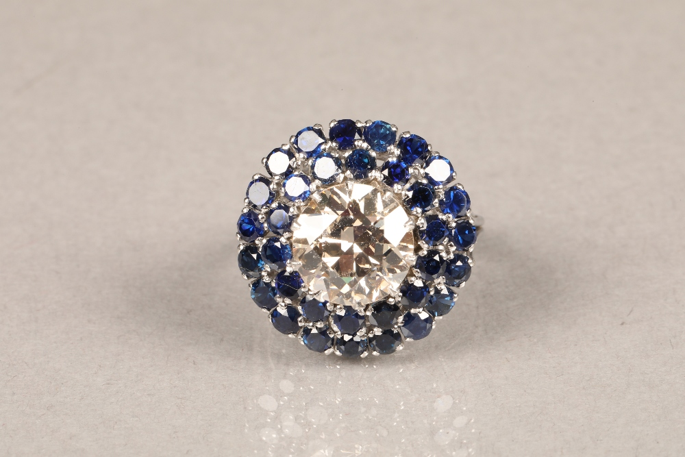 A diamond and sapphire three tiered circular cluster ring, centrally set with brilliant cut - Image 2 of 6