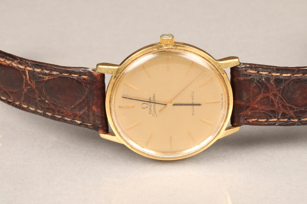 Gents 9 carat gold Omega Seamaster automatic wrist watch, dial with hour markers and sweeping