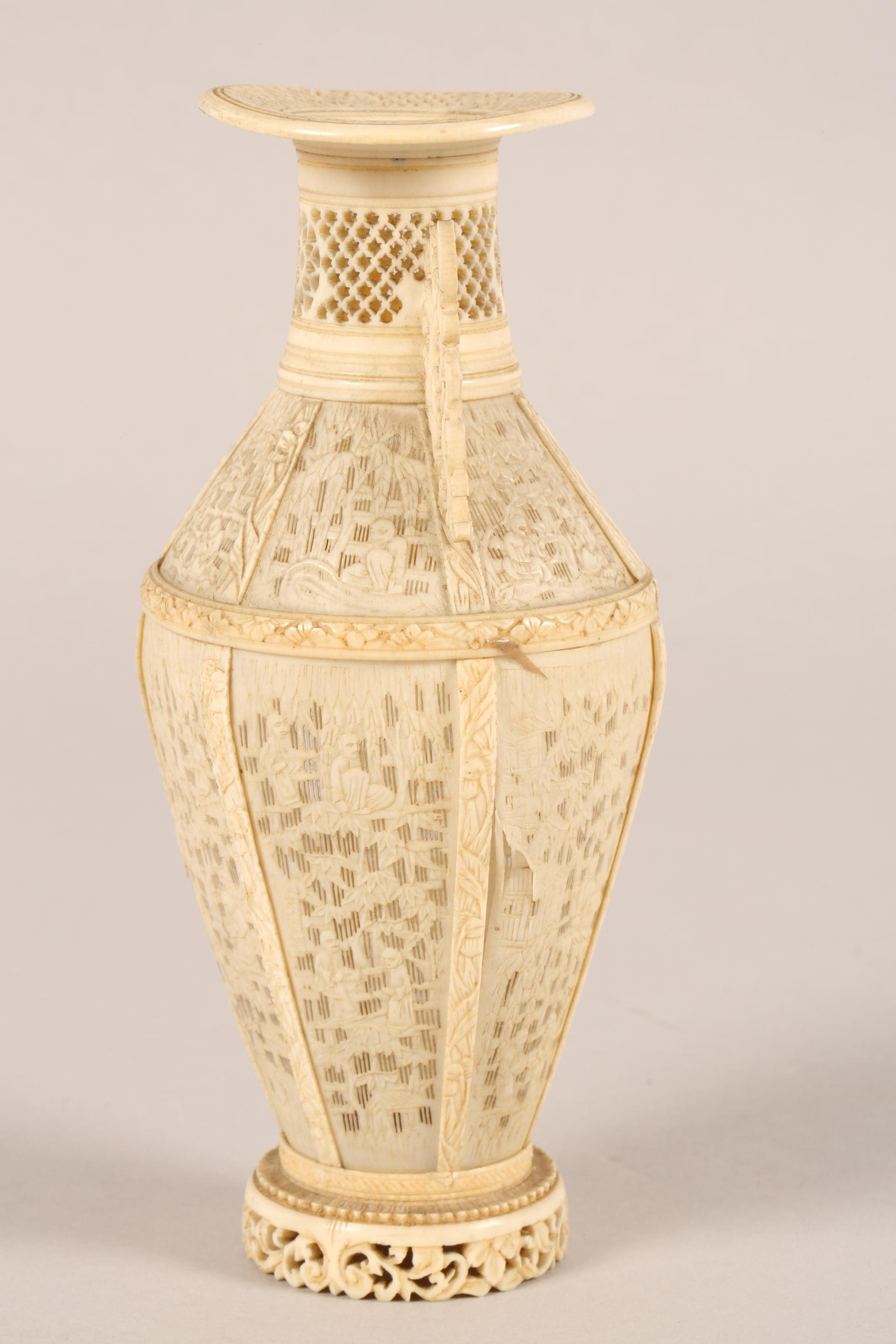 19th century Chinese Canton reticulated ivory twin handled vase (minor damages) 17.5cm high. - Image 4 of 7
