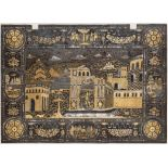 Ⓦ A FINELY DECORATED IRON PLAQUE FROM A DROP-FRONT CABINET^ DECORATED WITH AN ARCHITECTURAL SCENE