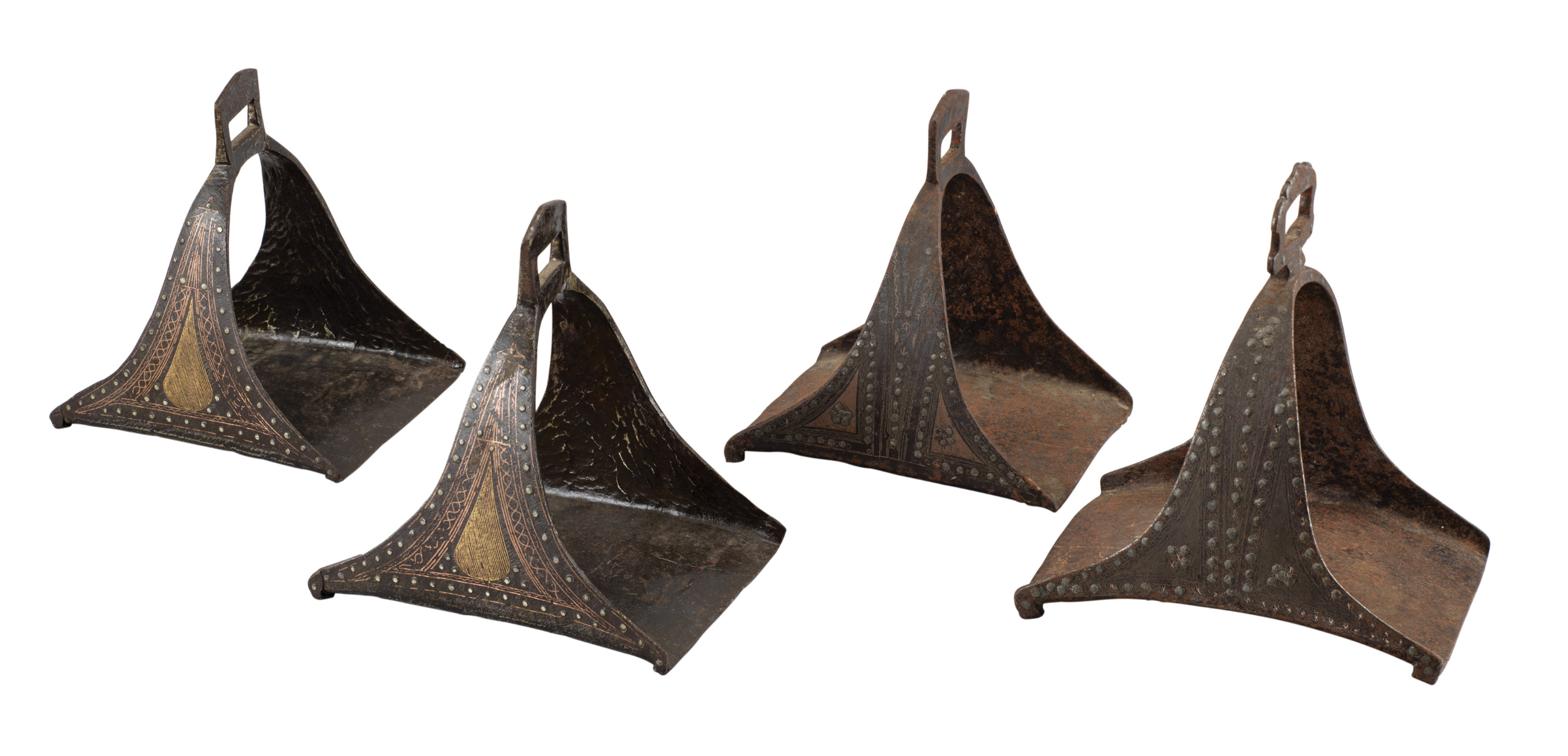 A PAIR OF NORTH AFRICAN STIRRUPS^ AND TWO SIMILAR STIRRUPS^ MOROCCO^ 19TH CENTURY