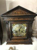An Edwardian carved pine cased bracket clock with brass and enamelled dial