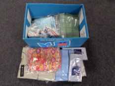 A box of new and un-worn clothing, shirts,