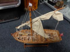 A wooden masted boat on stand CONDITION REPORT: height 48 cm length 57 cm width 18
