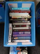 A box of books including autobiographies,