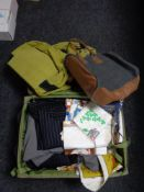 A luggage case and a holdall of clothing, new tea towels,