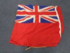 A Naval flag CONDITION REPORT: This measures 223cm by 94cm.