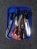 Seven pairs of scissors.