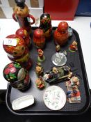 A tray of Russian doll figures, ceramic dish,