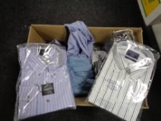 A box of new clothing including shirts,