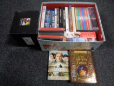 A quantity of DVDs and box sets.