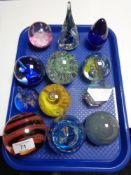 Twelve decorative glass paperweights.