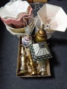 A box of decorative table lamps and shades