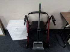 A walking aid together with a G-tech vac and loom box