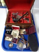 A casket of costume jewellery, wrist watches,