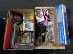 A box of household sundries including extension leads, portable sanitizer, books, video tapes,