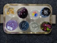 A collection of eight Caithness paperweights.
