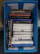 A box of books including The Royal Family,
