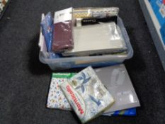 A box of mattress covers, new bedding,