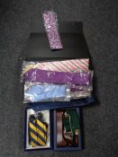 A collection of new gent's ties and braces.