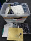 A crate of new and un-used clothing - shirts,