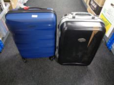 A hardshell luggage case , in new condition and one further similar case.