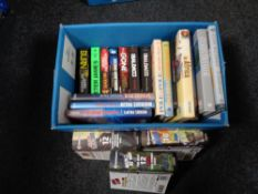 A box of books including Michael Palin,
