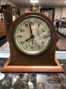 An Edwardian mahogany and pine mantel clock with silvered dial and key