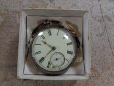 A silver pocket watch with key