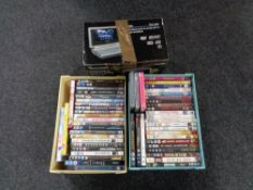 Two boxes of DVDs and a portable DVD player.