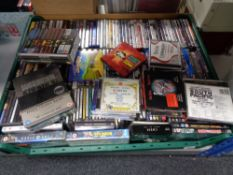 A crate of very large quantity of CDs and DVDs