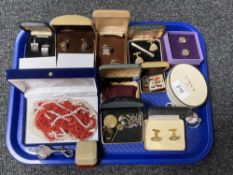 A collection of costume jewellery, cufflinks, coral necklace etc.
