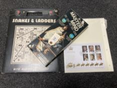 A vintage Master Mind logic game together with Snakes and Ladders and a Limited edition 60th