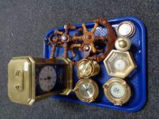 A reproduction Submarine brass clock together with nautical replicas of clocks etc