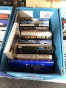 A box of books including Andy McNab, Patricia Cornwell,