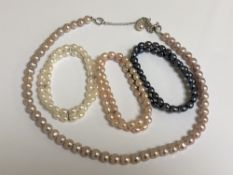 Pink, white and grey pearls - A necklace and three bracelets.