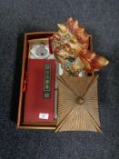 An oriental style lacquered tray, miniature folding screen, scent flask and a ceramic lion figure.