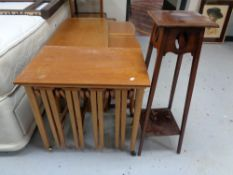 A twentieth century teak table fitted with four beneath together with an Edwardian plant stand