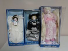 Three Royal Doulton Nisbet Collection dolls in boxes.