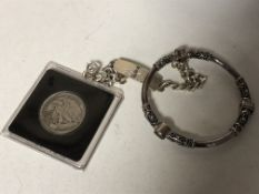 A Sterling silver designer bangle, together with a silver half dollar and curb bracelet.