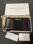 An Amanda Wakeley leather clutch purse, in retail dust cover and box.