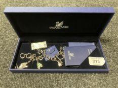 A Swarovski crystal charm bracelet, with retail tags and box.