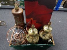 A crate of table lamps, metal framed ceiling lights,