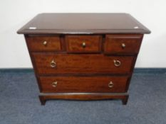 A Stag five drawer chest